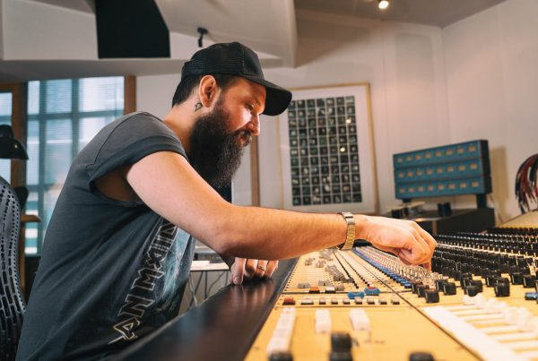 Drew Bang working a mixing console