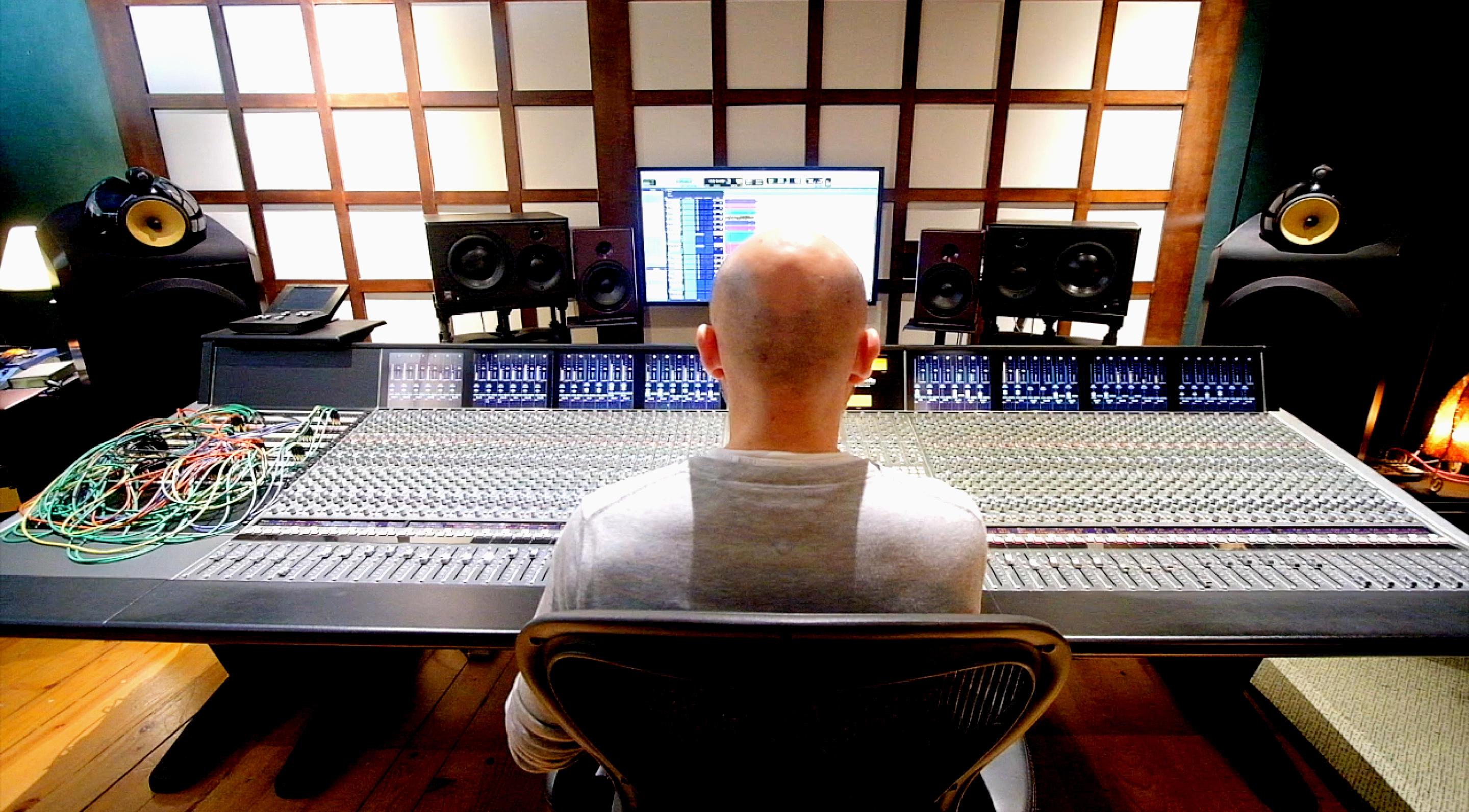 A man sitting in front of a mixing console